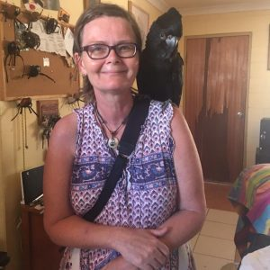 Donni Hakanson with black cockatoo Max on her shoulders.